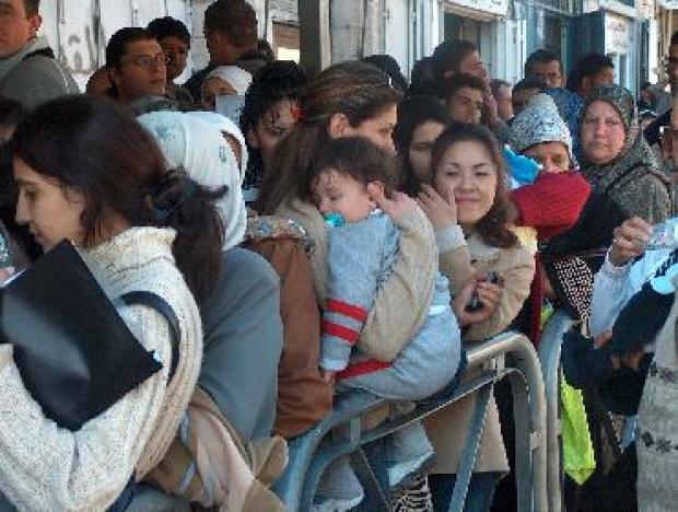 <p>[1642] 16  Palestinians waiting in long lines at the Israeli Ministry of the Interior in East Jerusalem.</p><p>Photo credit: Nidal Kana'ane, B'Tselem</p>