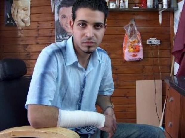 <p>[6471] 28  Murad Abu Lafah, 21 years old, was used as a human shield and beaten by IDF soldiers, al-Am'ari refugee camp, Ramallah district.</p><p>Photo credit: Iyad Hadad, B'Tselem</p>