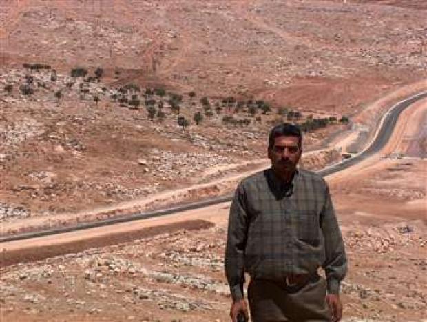 <p>[7278] 11  Mwafek al-Khatib, at the separation barrier near Hizma. The barrier Khatib's flock of sheep from its pasture land.</p><p>Photo credit: Kareem Jubran, B'Tselem</p>