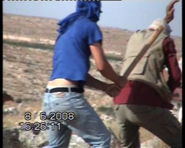 "<p>[9744] 8  A settler attacks the Nawaj'ah family near Susiya. 8 June 2008.</p><p>Photo credit: Muna a-Nawaj'ah, ""Shooting Back"" B'Tselem</p>"