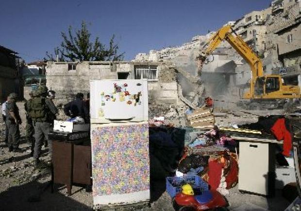 <p>[10640] 5  A bulldozer demolishes a Palestinian house in Silwan November 5, 2008.</p><p>Photo credit: Yannis Behrakis, © Reuters</p>