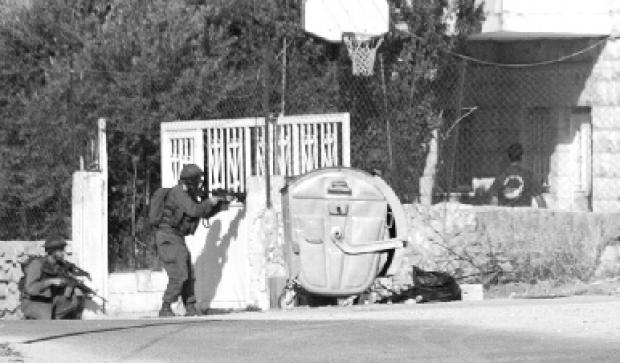 "<p>[110] 1  IDF soldiers use a Palestinian civilian as a ""human shield.""</p><p>Photo credit: Gihad Nga</p>"