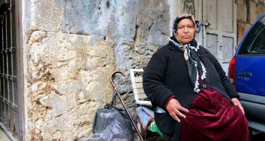 Rihab Kafr'ani, Mithal's sister, by their shop. Photo by Yoav Gross, B'Tselem 23 Feb. 2016